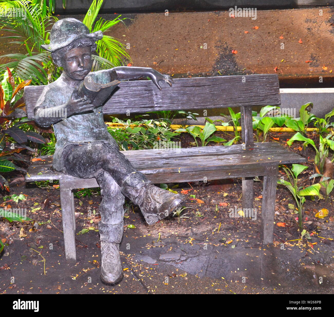 Prime A Boy Sitting On A Bench Reading A Book Bronze Statue In The Pabps2019 Chair Design Images Pabps2019Com