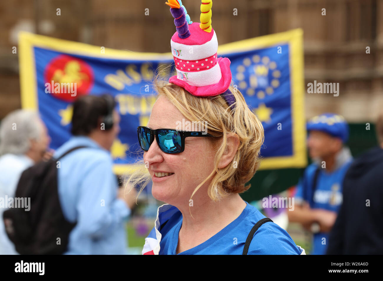 Colourful dressed stop Brexit campaigner in the front of the Houses of Parliament, London, UK Stock Photo