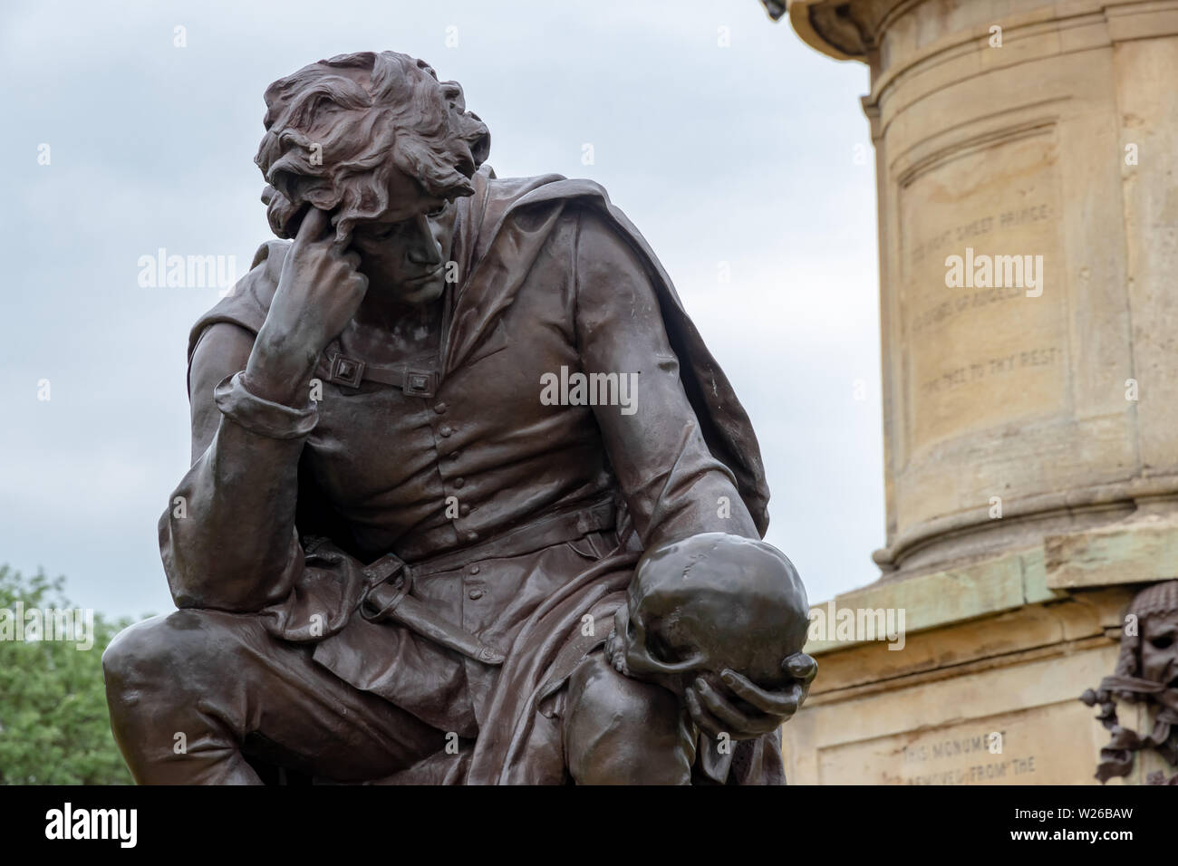Hamlet with the skull of the jester Yorick at the Gower Memorial in Stratford Upon Avon - Stock Image