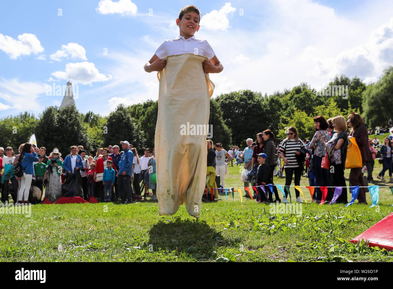 Moscow, Russia. 06th July, 2019. MOSCOW, RUSSIA - JULY 6, 2019: Teenagers compete in a sack race at Sabantui (a traditional summer festival celebrated primarily by the Tatars and the Bashkirs) in Kolomenskoye Park. Sergei Savostyanov/TASS Credit: ITAR-TASS News Agency/Alamy Live News - Stock Image