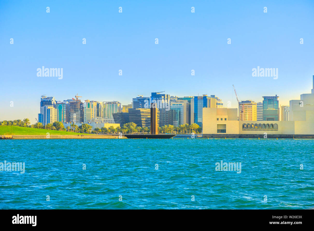 Doha, Qatar - February 20, 2019: Steel Obelisk, Museum of Islamic Art and Mia Park in Doha Bay from Dhow boat. Qatari capital in Middle East, Arabian Stock Photo