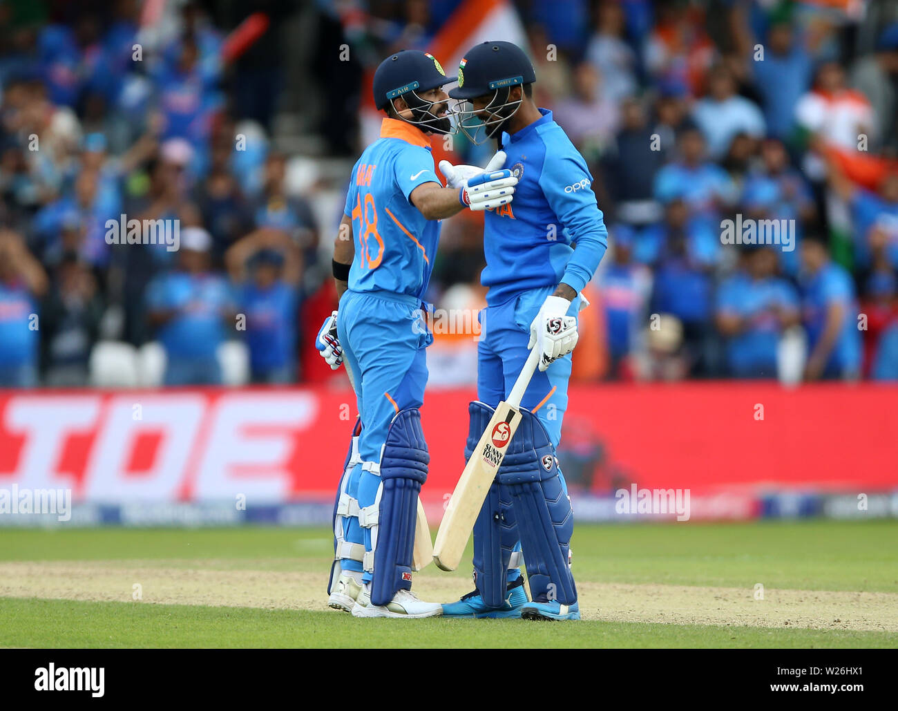 India's KL Rahul celebrates his century with Virat Kohli during the ICC Cricket World Cup group stage match at Headingley, Leeds. - Stock Image