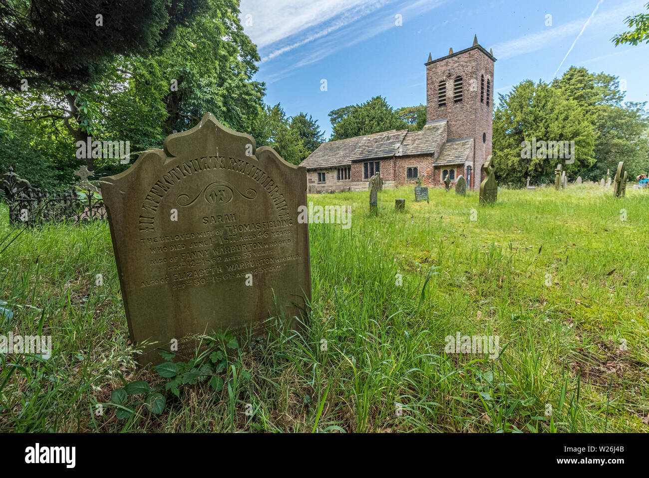 St Werburgh's Old Church, Warburton near to the Cheshire town of Lymm. Named after a Saxon abbess who became the patron saint of Chester. The  oldest - Stock Image