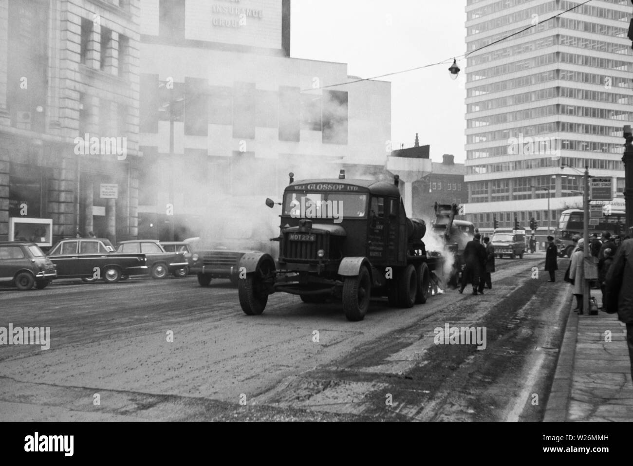 Known as the 'Kings of Tarspraying',W&J Glossop Ltd was a company based in West Yorkshire. The image was taken during the early 1960s The roadworking vehicle is a Scammell reg no HDT 228 - Stock Image