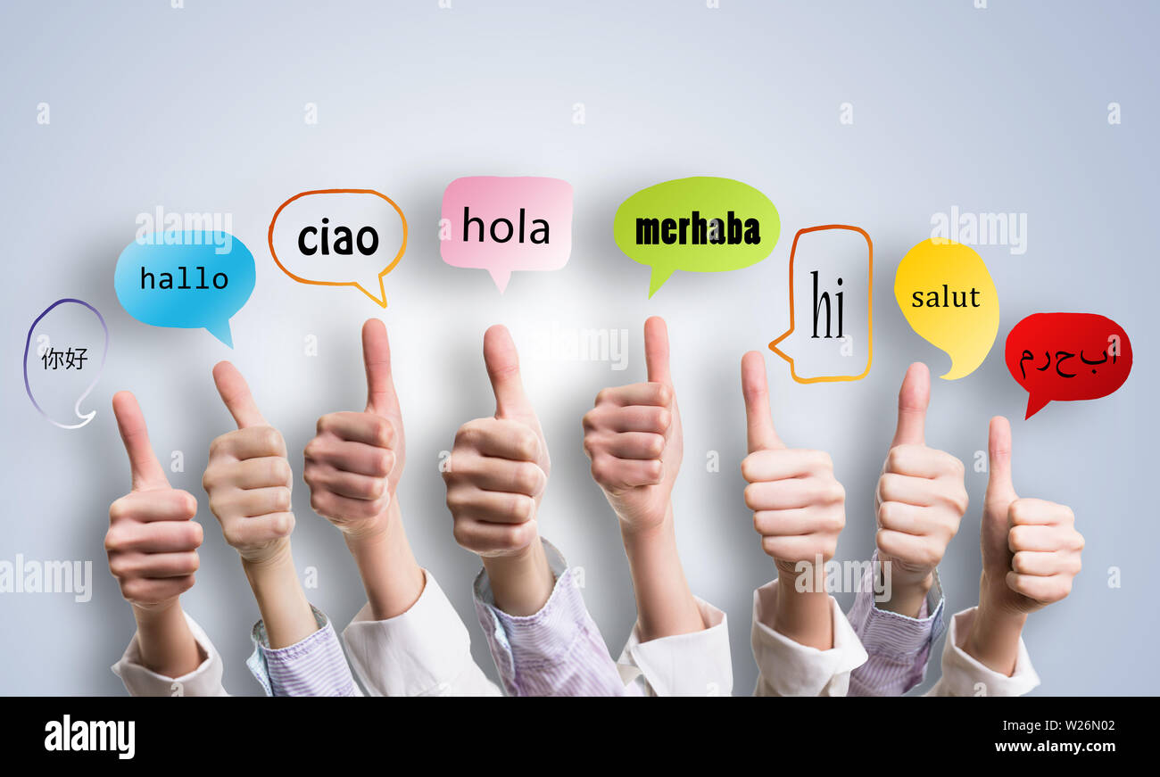 many thumbs with the word 'welcome' in many languages in speech bubbles - Stock Image