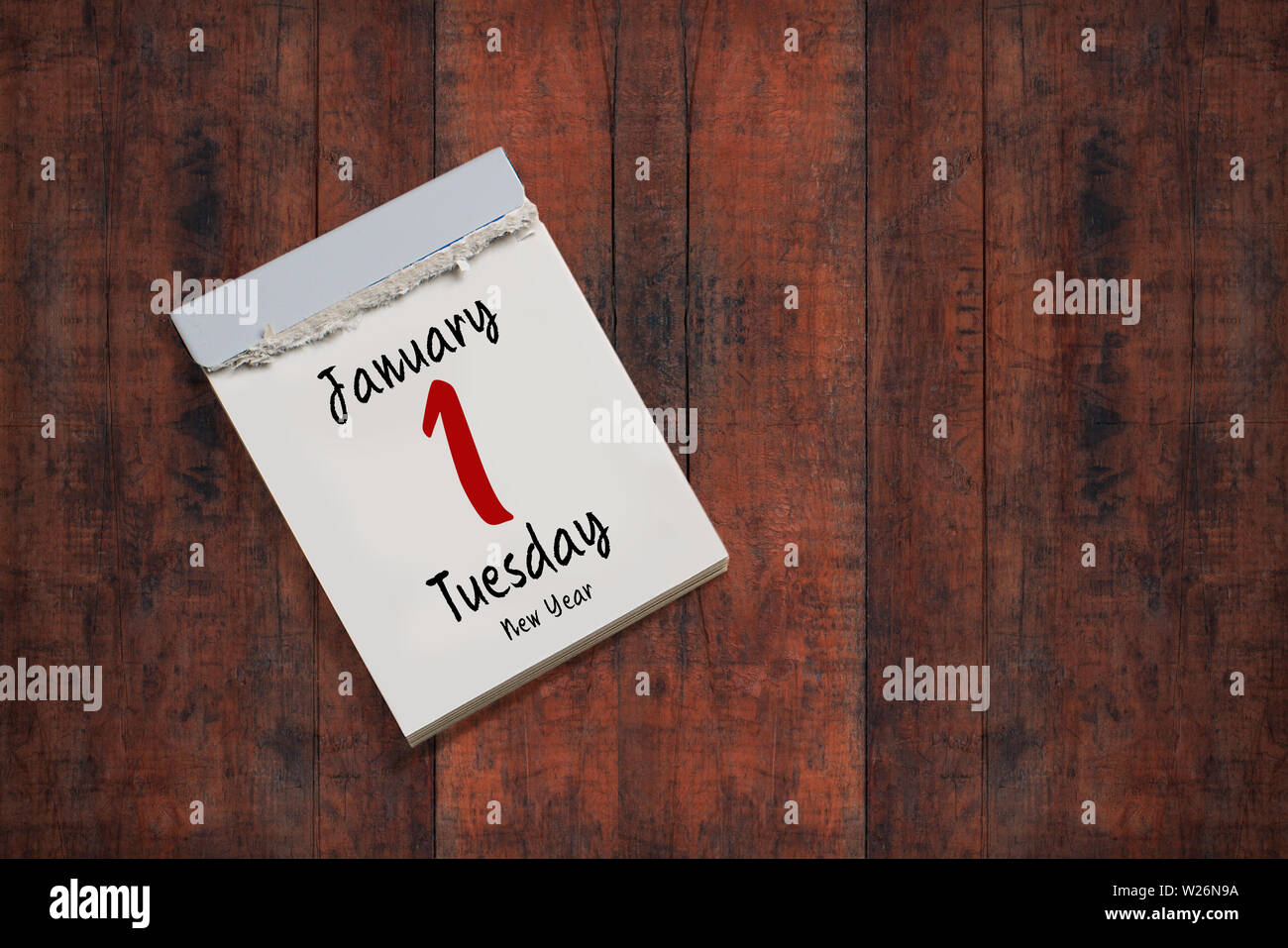 tear-off calendar with 1st of january 2019 on wooden background - Stock Image