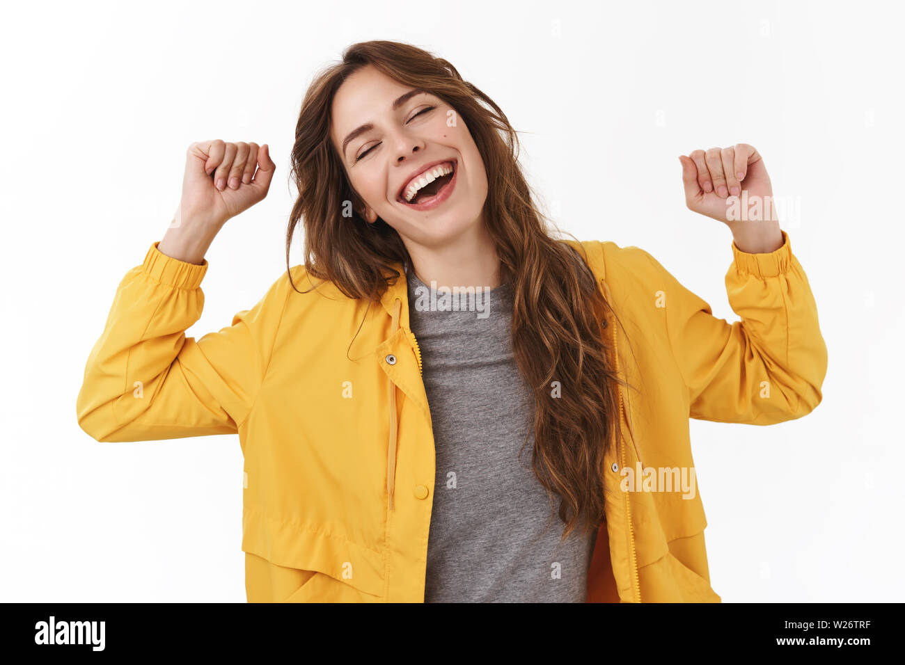 Lazy girl wanna take nap doing nothing all day. Silly cute european woman yawning hands raised stretching body feel energized waking up afternoon stan - Stock Image