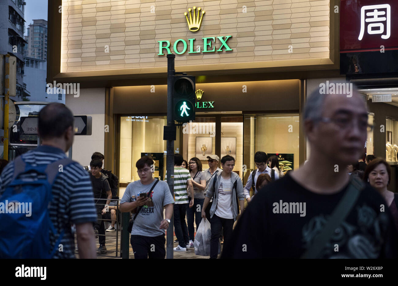 Hong Kong, China. 17th May, 2019. Commuters pass by the Swiss luxury watchmaker Rolex branch in Hong Kong. Credit: Budrul Chukrut/SOPA Images/ZUMA Wire/Alamy Live News - Stock Image