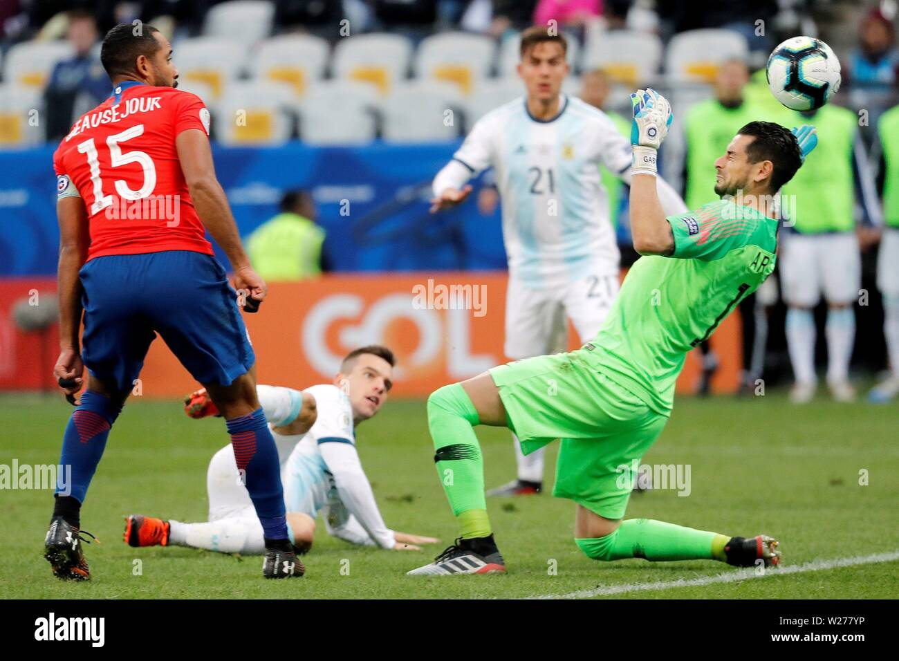 Sao Paulo, Brazil. 06th July, 2019. Argentina's Nicolas Tagliafico (C-down) in action against Chile's goalkeeper Gabriel Arias during the Copa America 2019 3rd place soccer match between Argentina and Chile, at Arena Corinthians Stadium in Sao Paulo, Brazil, 6 July 2019. Credit: Paulo Whitaker/EFE/Alamy Live News - Stock Image