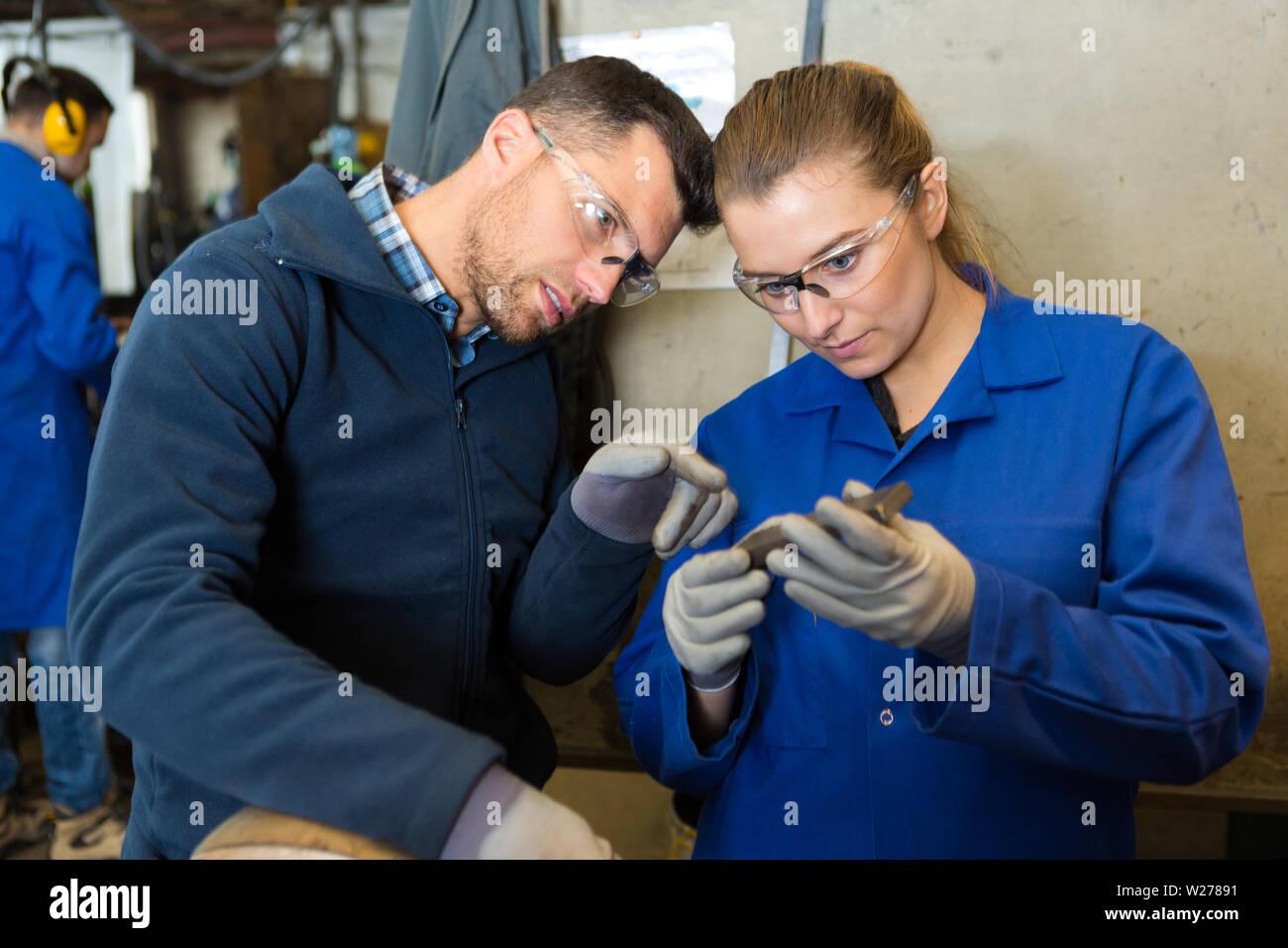 man and woman mechanics atwork - Stock Image