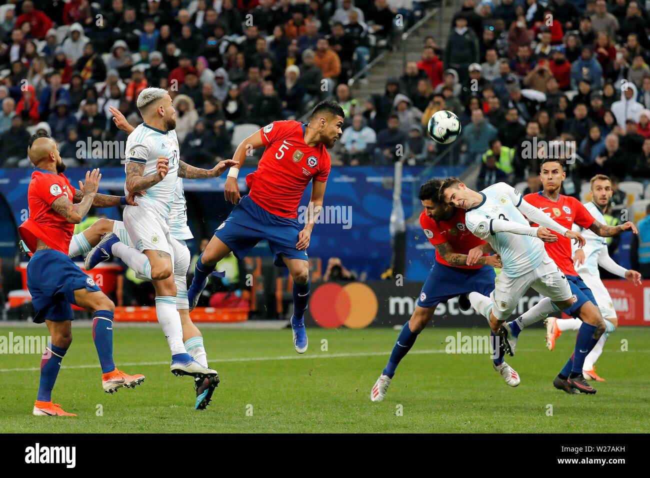 Sao Paulo, Brazil. 06th July, 2019. Chile's Paulo Diaz (3L) vies for the ball with Argentina's Tagliafico during the Copa America 2019 3rd place soccer match between Argentina and Chile, at Arena Corinthians Stadium in Sao Paulo, Brazil, 6 July 2019. Credit: Paulo Whitaker/EFE/Alamy Live News - Stock Image