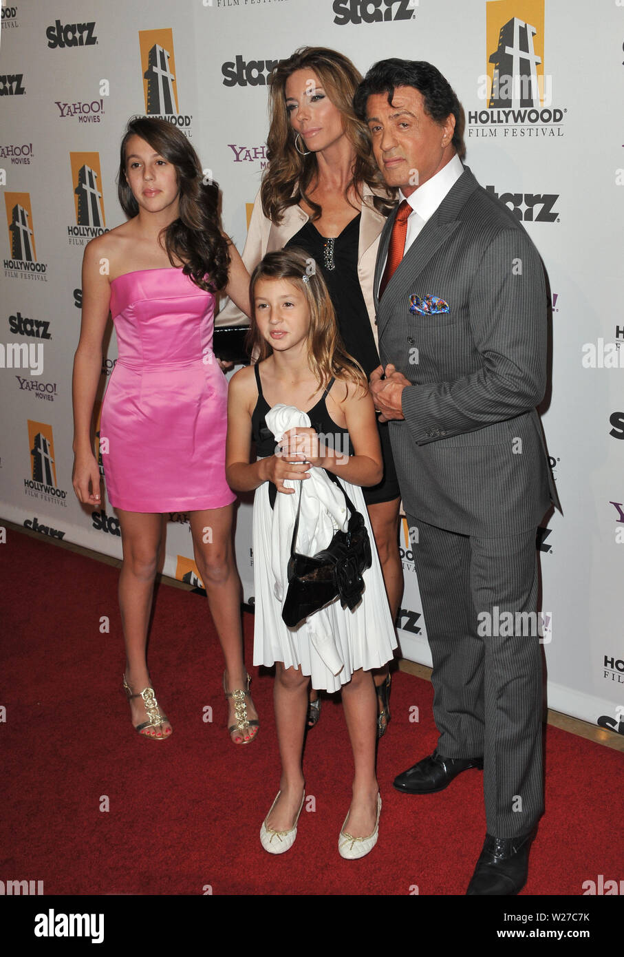 LOS ANGELES, CA. October 25, 2010: Sylvester Stallone & Jennifer Flavin & daughters at the 14th Annual Hollywood Awards Gala at the Beverly Hilton Hotel. © 2010 Paul Smith / Featureflash - Stock Image