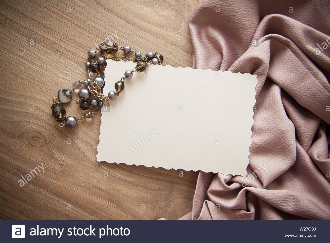 backgrund with black pearls and postcard for text - Stock Image
