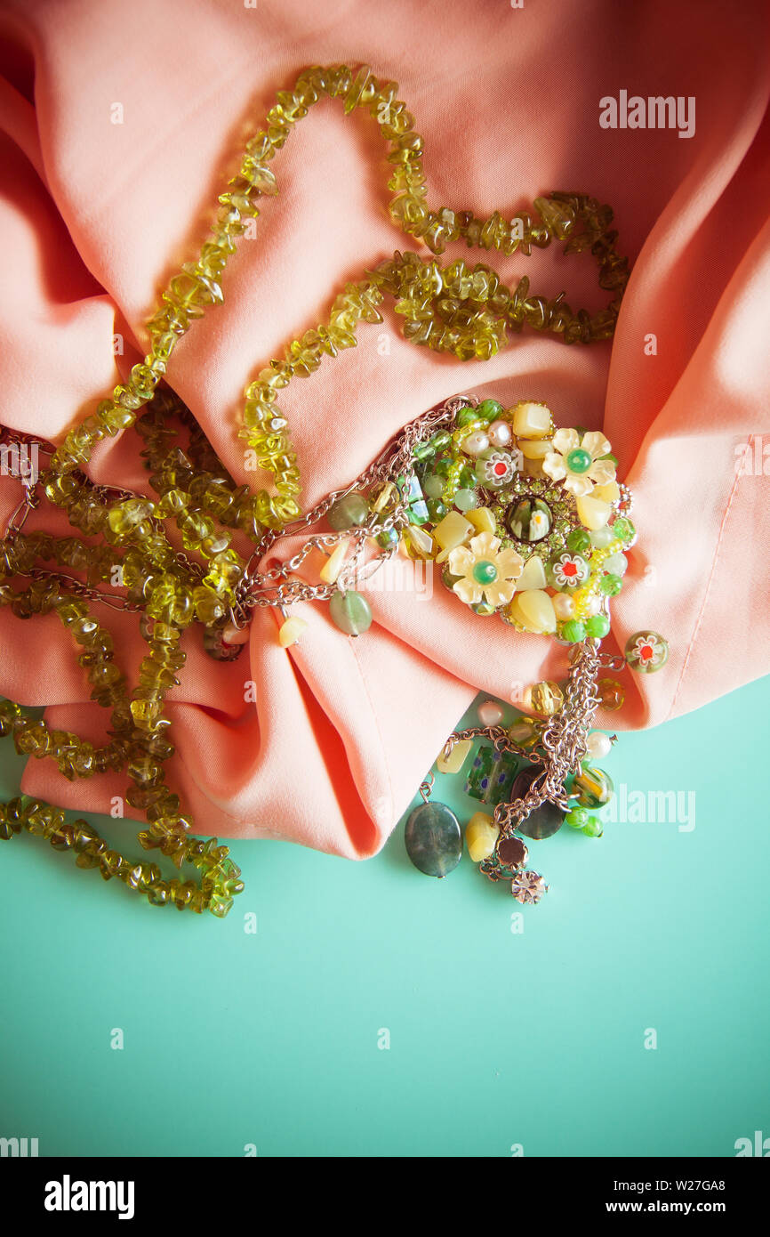 vintage colorful background with granny`s green necklace. Memories concept, photo with copy space - Stock Image