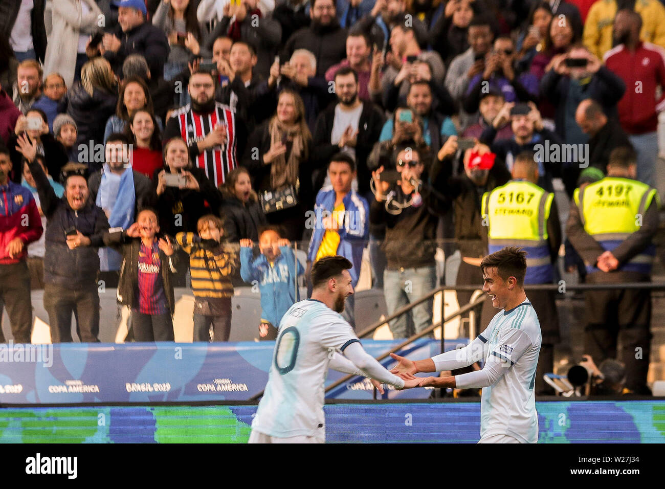 6th July 2019, Arena Corinthians Stadium, Sao Paulo, Brazil; Copa America international football, 3rd-4th playoff final, Argentina versus Chile; Paulo Dybala of Argentina celebrates his goal for 2-0 in minute 22 of the game with Lionel Messi 2-0 - Stock Image