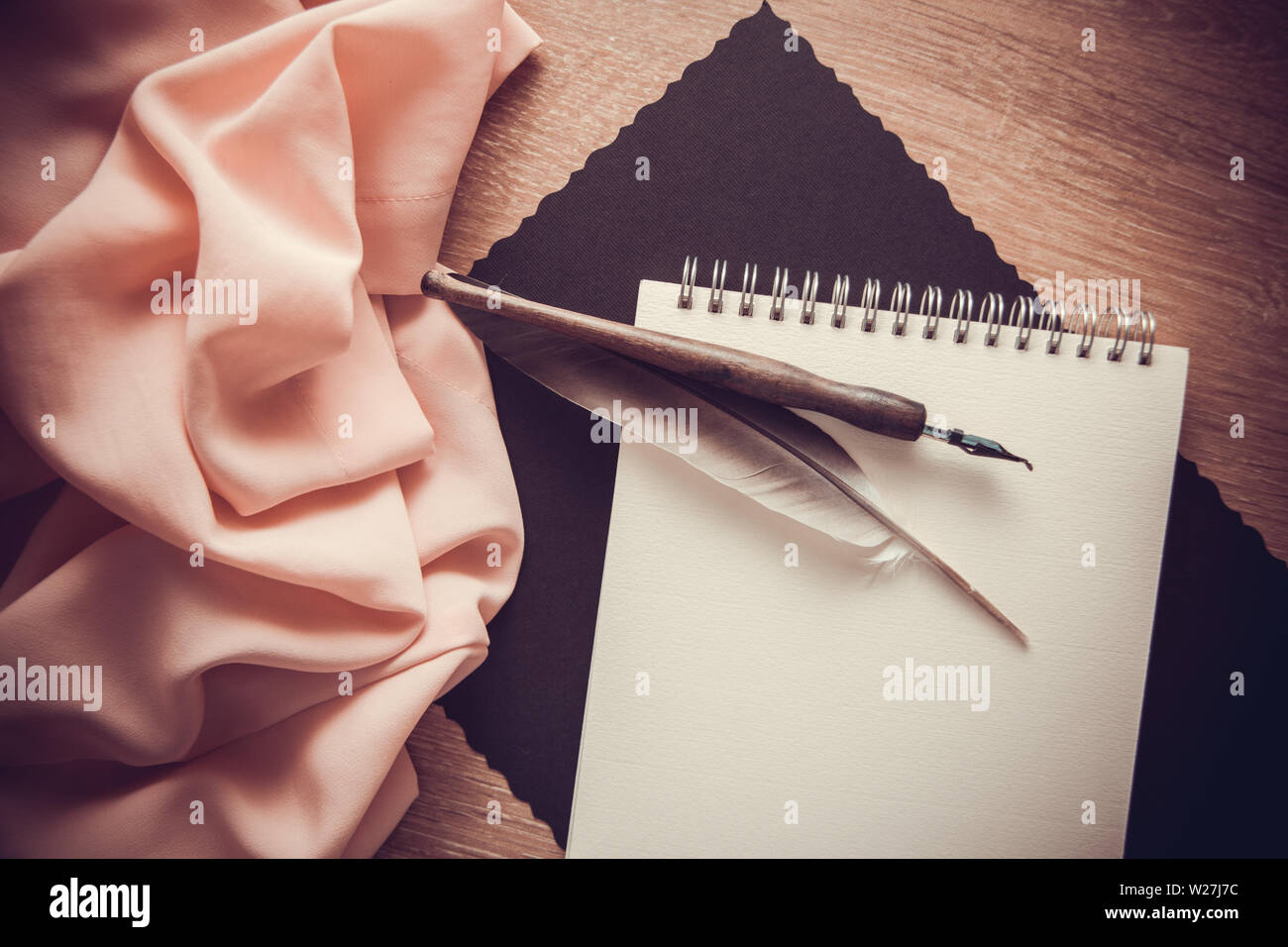 poetry & writing music concept background with orange background and postcard with copy space - Stock Image