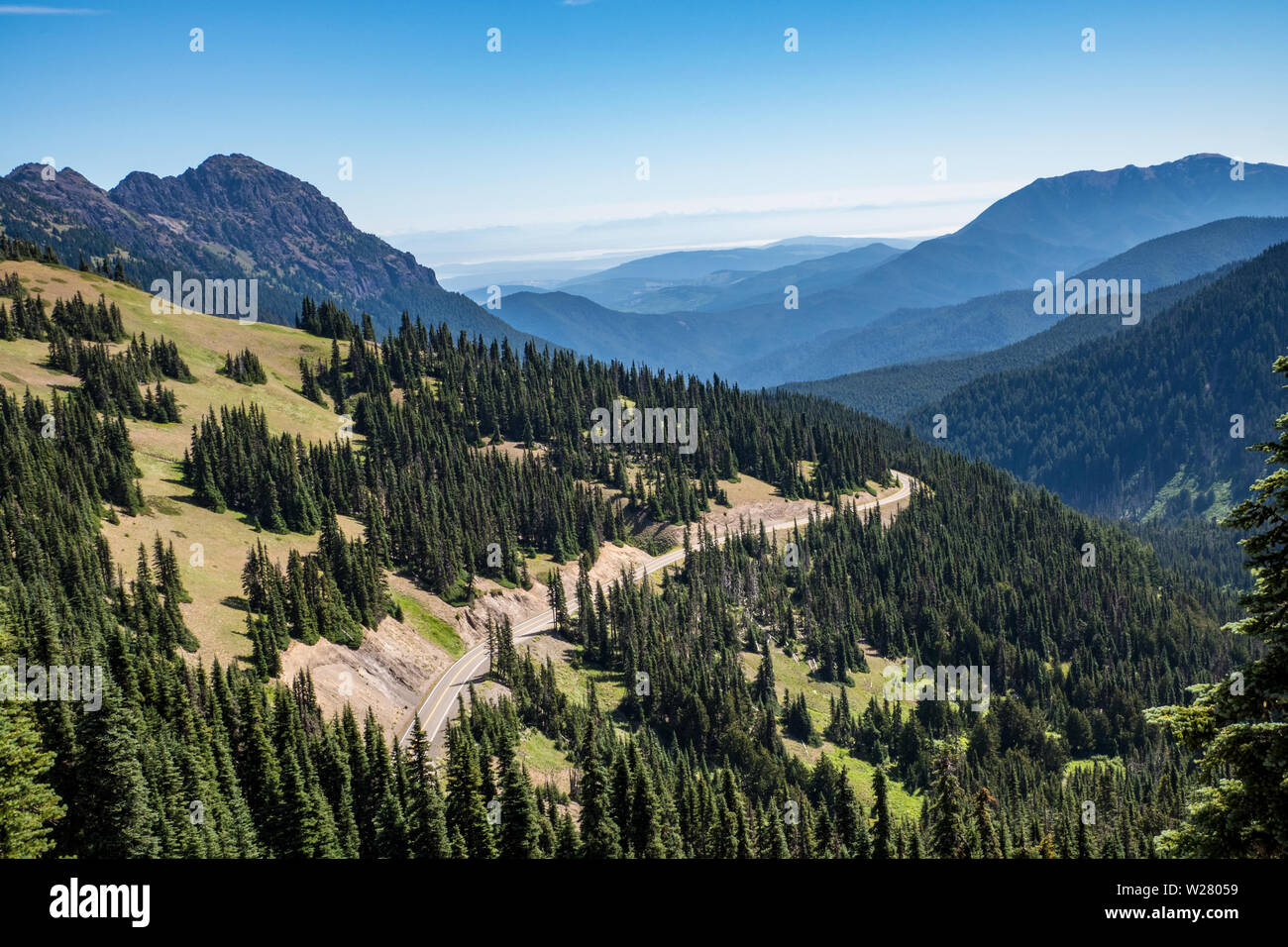 Hurricane Ridge, Olympic National Park, Washington, USA.  View of mountain range and highway from a hiking trail. Stock Photo