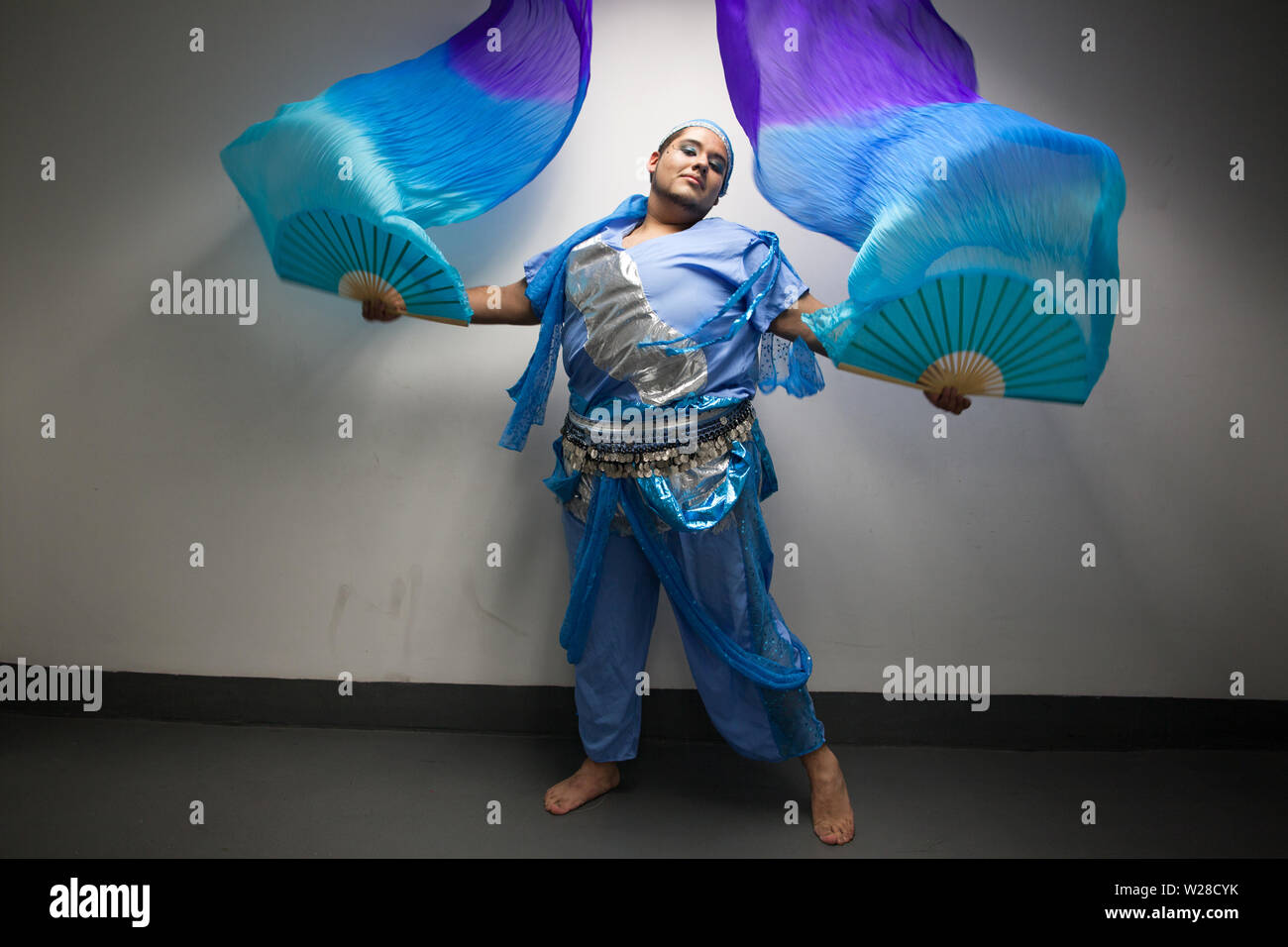Juan Luis Vanegas Bravo, a Mexican 18 year old teenager, portrayed with a belly dance costume in Mexico City, Mexico on May 17, 2012. Juan Luis has grade three obesity, a genetic condition he inherited from his father who died of morbid obesity 6 years ago. He became obese at age 3 and reached his maximum weight of 146 kilos at age 16 when he decided to find a way to treat his disease and prevent an early death like his father. He was suffering from diabetes and hypertension when a doctor proposed he get a bariatric surgery. In 2009 he received the surgery and was able to lose weight and adopt - Stock Image