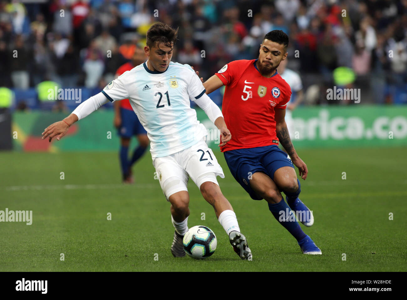 Sao Paulo, Brazil. 6th July, 2019. Argentina's Paulo Dybala (L) competes with Paulo Diaz of Chile during the 3rd place match of Copa America 2019 between Argentina and Chile in Sao Paulo, Brazil, July 6, 2019. Credit: Rahel Patrasso/Xinhua/Alamy Live News - Stock Image