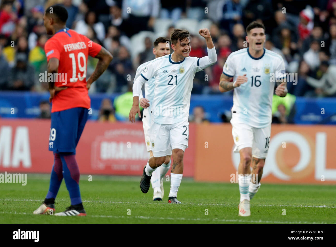 Sao Paulo, Brazil. 6th July, 2019. Argentina's Paulo Dybala (2nd R) celebrates after scoring during the 3rd place match of Copa America 2019 between Argentina and Chile in Sao Paulo, Brazil, July 6, 2019. Credit: Francisco Canedo/Xinhua/Alamy Live News - Stock Image