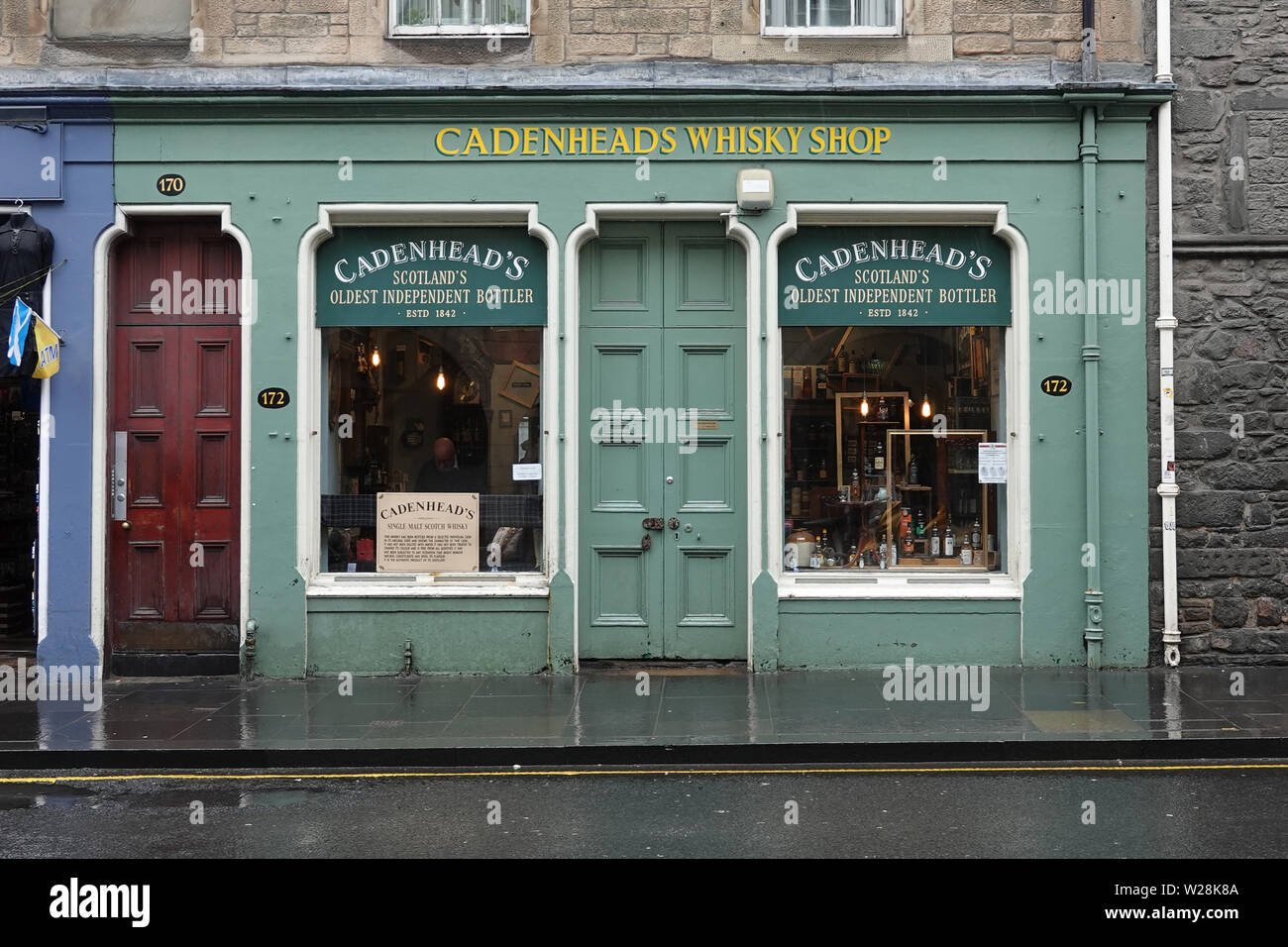 Edinburgh, Scotland - June 13, 2019: The storefront for Cadenhead's Whisky Shop, established in 1842, is shown along the Royal Mile. Stock Photo