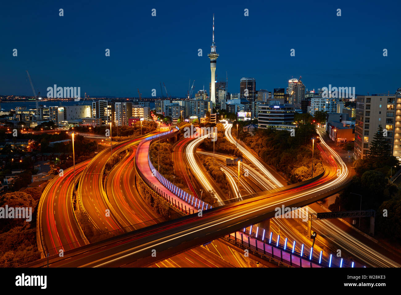 Motorways, Lightpath cycleway, and Sky Tower at dusk, Auckland, North Island, New Zealand - Stock Image