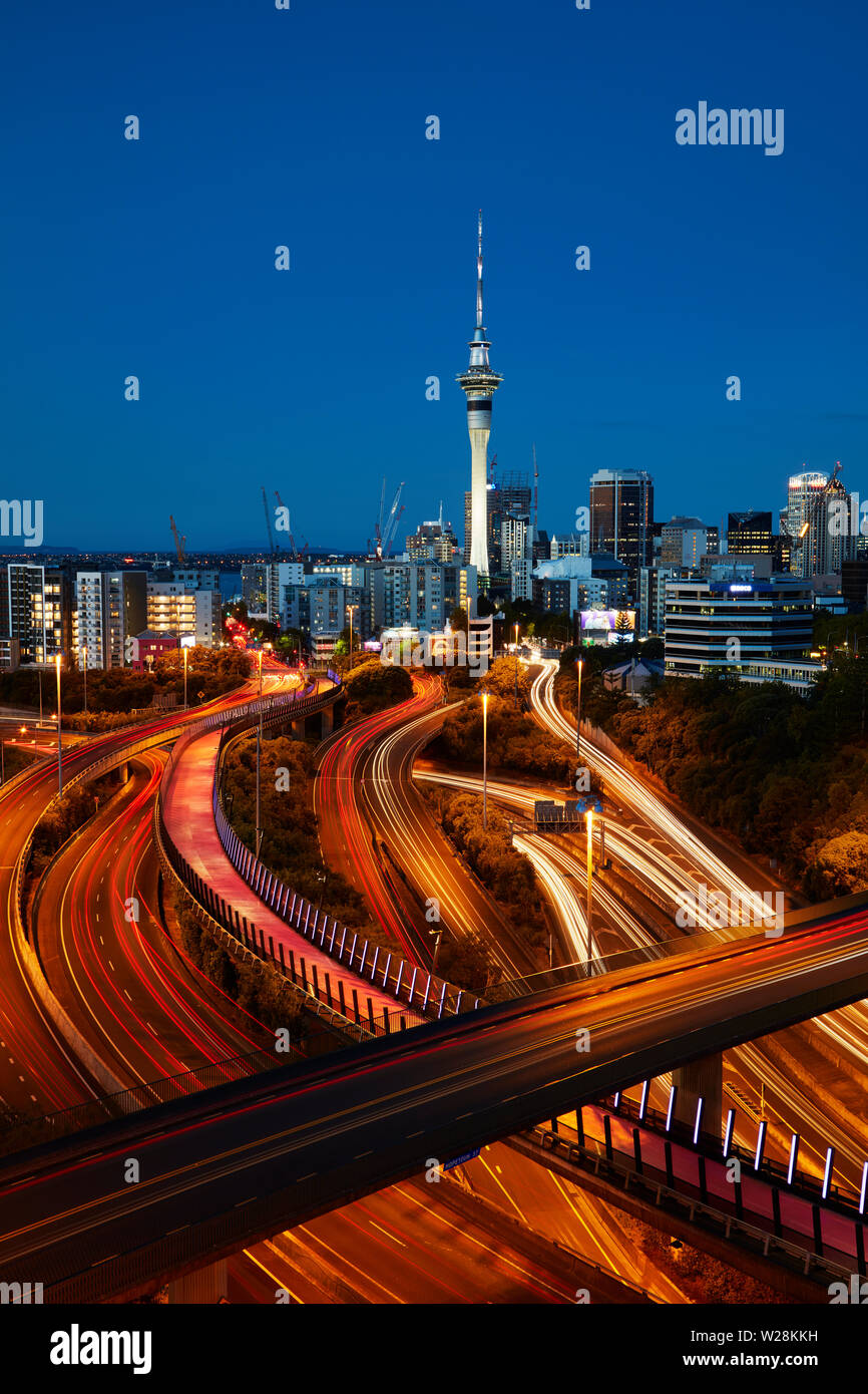 Motorways, Lightpath cycleway, and Sky Tower at dusk, Auckland, North Island, New Zealand Stock Photo