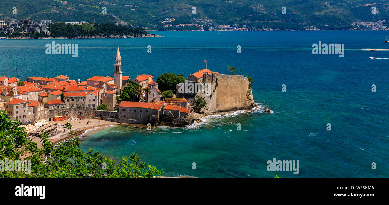Panoramic aerial view of Budva Old Town with the Citadel and the Adriatic Sea in Montenegro on the Balkans on a sunny day - Stock Image