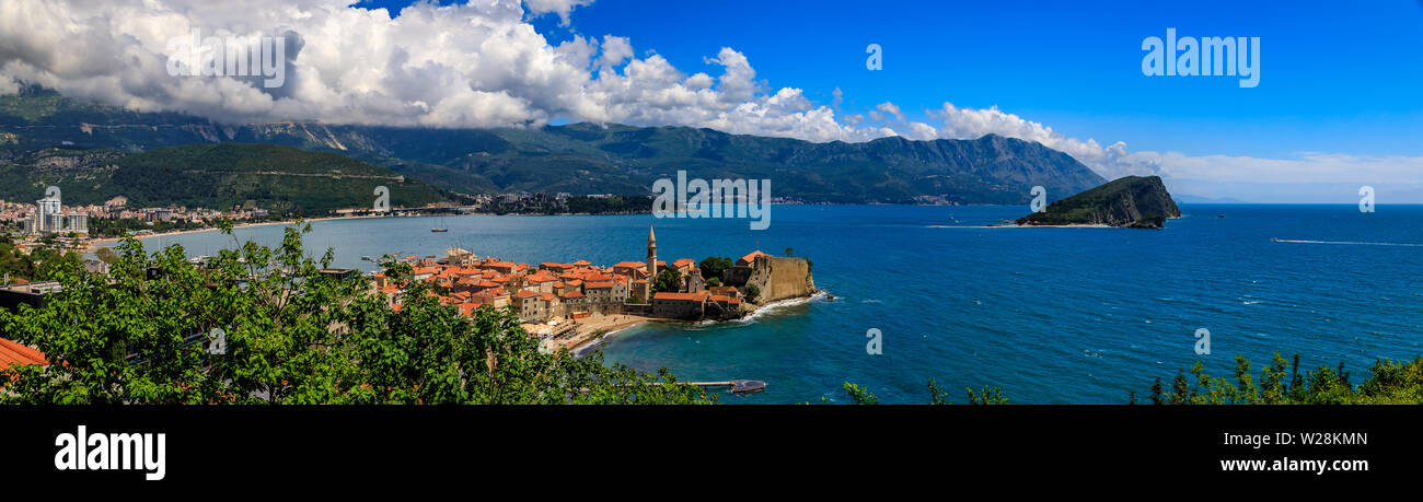 Aerial panorama of Budva Old Town with the Citadel and Island of St Nicholas or Hawaii in Adriatic Sea in Montenegro, on the Balkans on a sunny day - Stock Image