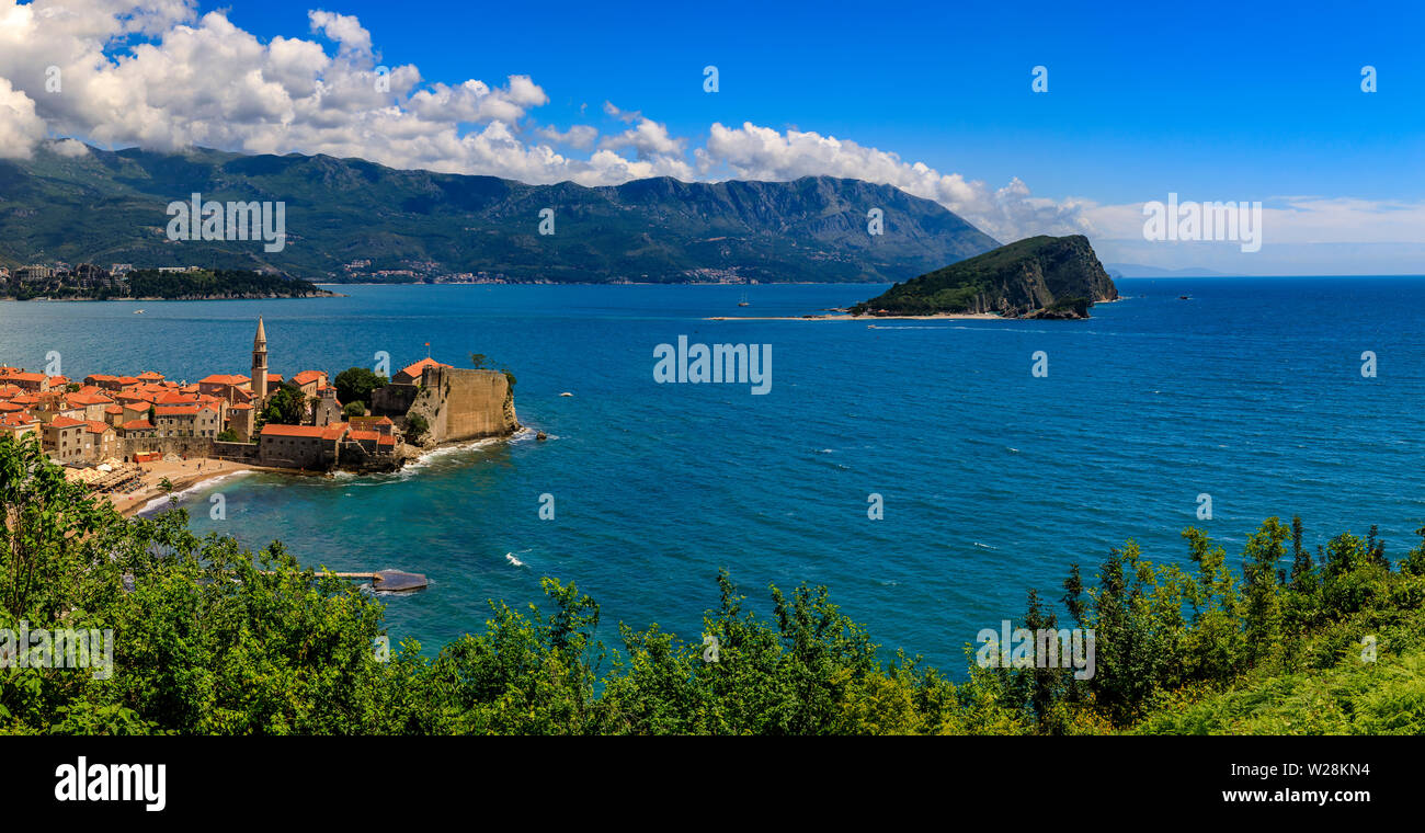 Aerial panorama of Budva Old Town with the Citadel and Island of St Nicholas or Hawaii in Adriatic Sea, in Montenegro on the Balkans on a sunny day - Stock Image