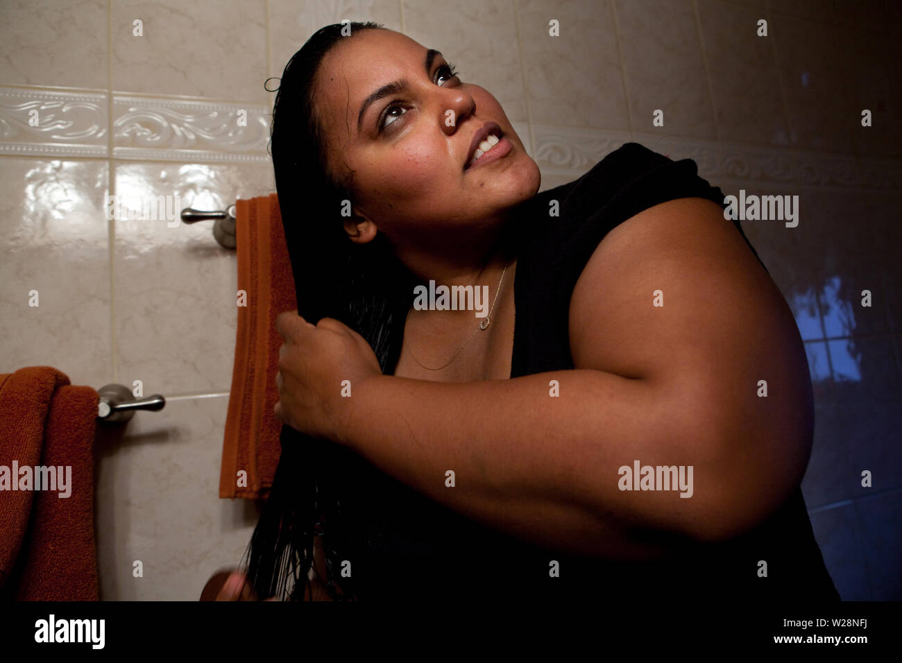 Falan Drying Her Hair At Her Home In New York City New York United States On April 8 2011 Falan Abreu Is An American Girl With Morbid Obesity She Will Soon Have