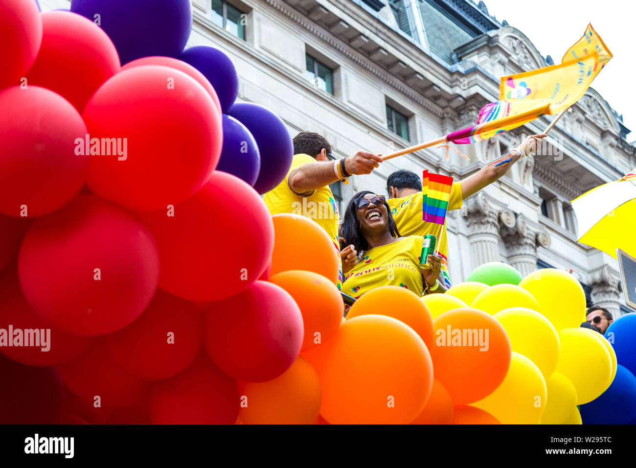 6 July 2019 - People celebrating Pride on a float surrounded by colourful balloons, London Pride Parade, UK - Stock Image
