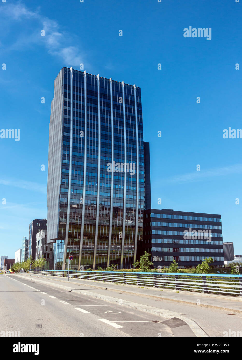 Tall building south of Vestamager metro railway station in Ørestad Amager Copenhagen Denmark Europe Stock Photo