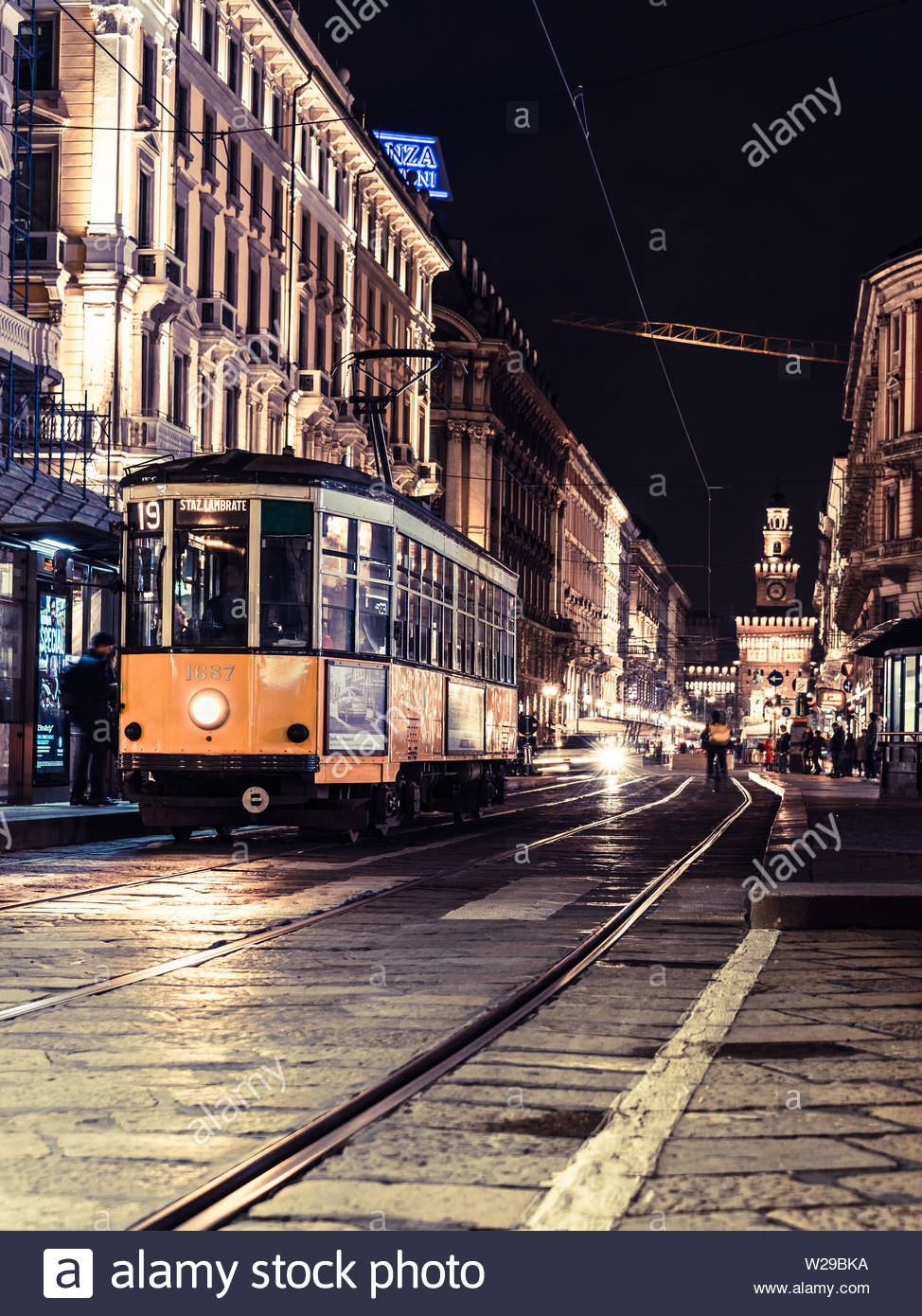 Milan, Italy, 09/11-18. Tram nr 19 has stopped at night, at busy tram station to let people in and out. - Stock Image