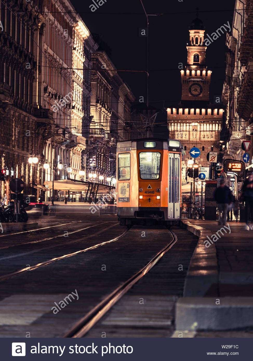 Milan, Italy, 09/11-18.Tram no 16 has stopped at night, at a busy tram station to let people in and out. - Stock Image