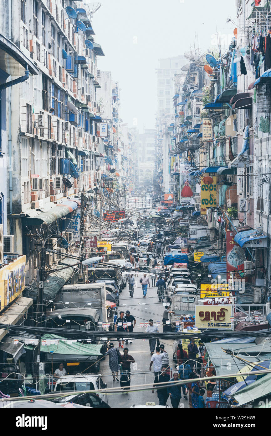 Yangon, Myanmar - March 2019: street view in the old town district. Vertical orientation. - Stock Image