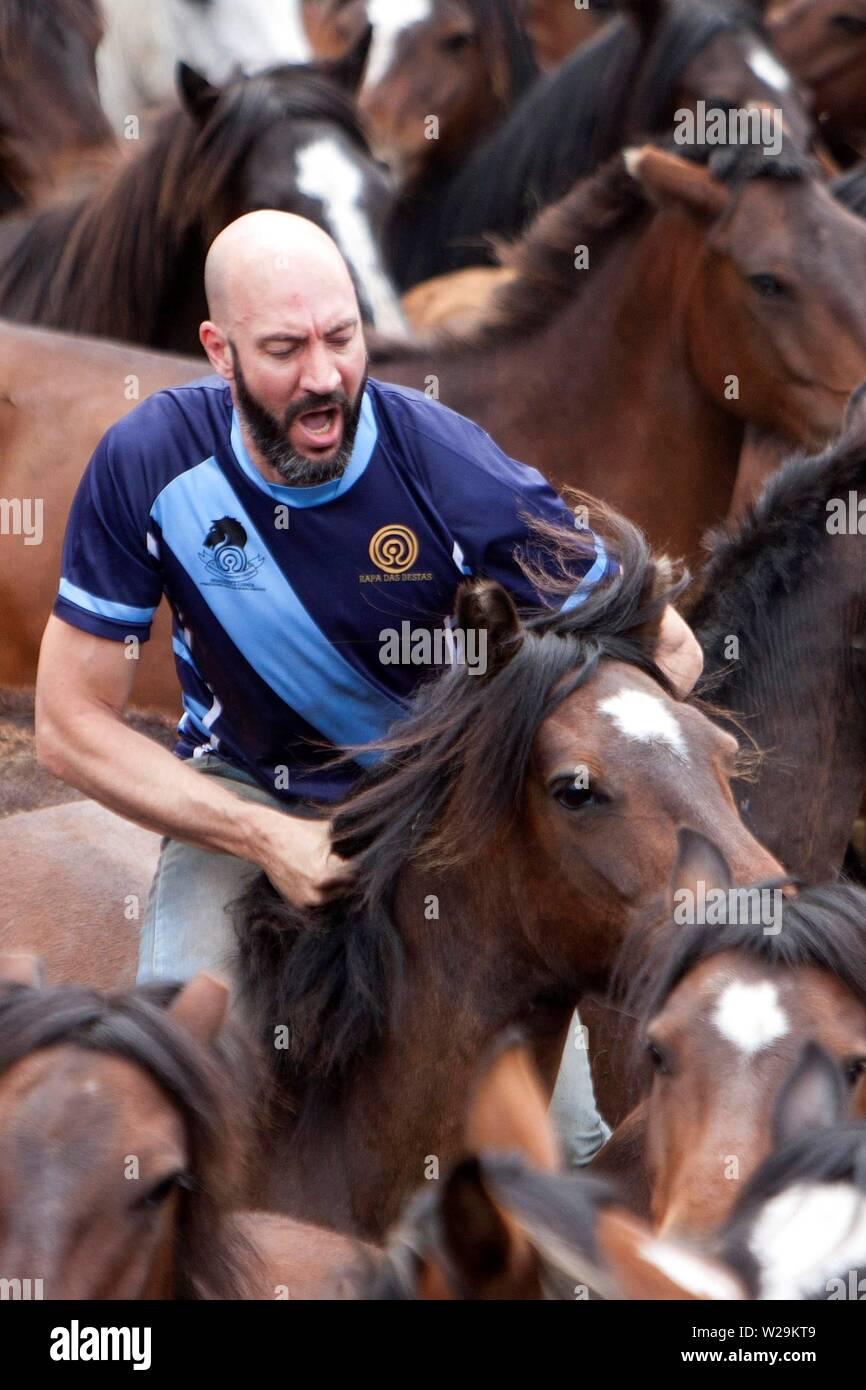 Sabucedo, Galicia, Spain  07th July, 2019  A young man takes