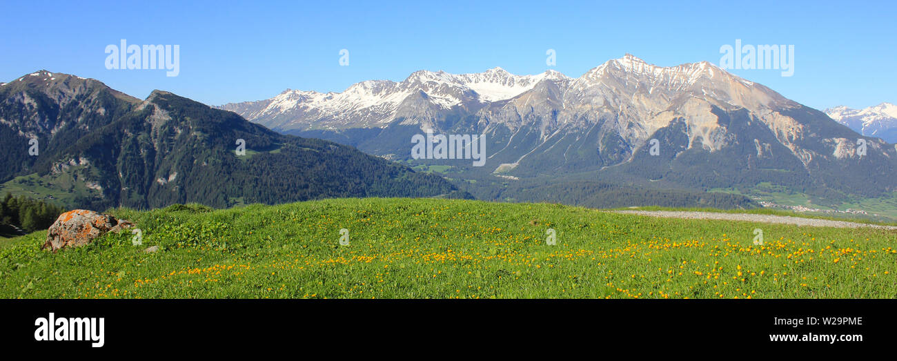 Mountains on Canton of Grisons seen from Obermutten, Switzerland. - Stock Image