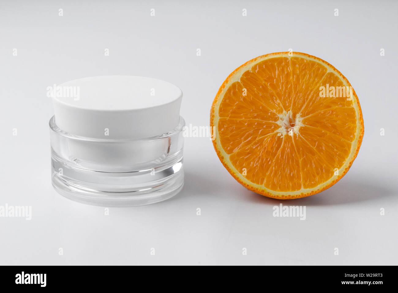 Jar Of Cosmetic Cream With Orange On White Background Blank