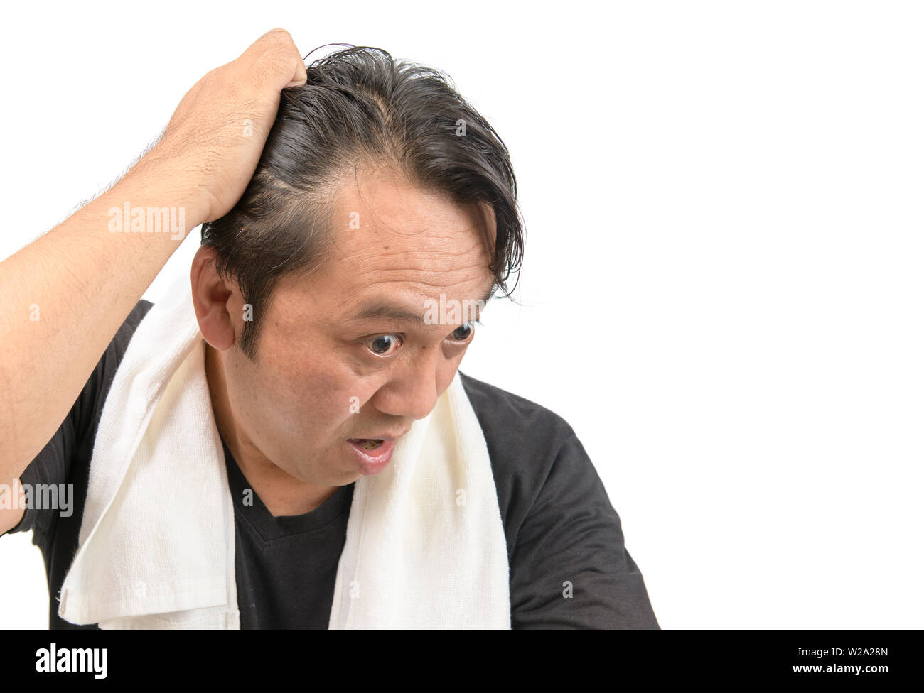 Middle-aged asian man worry about his  hair loss or alopecia and grey hair isolated on white background, Health care concept Stock Photo