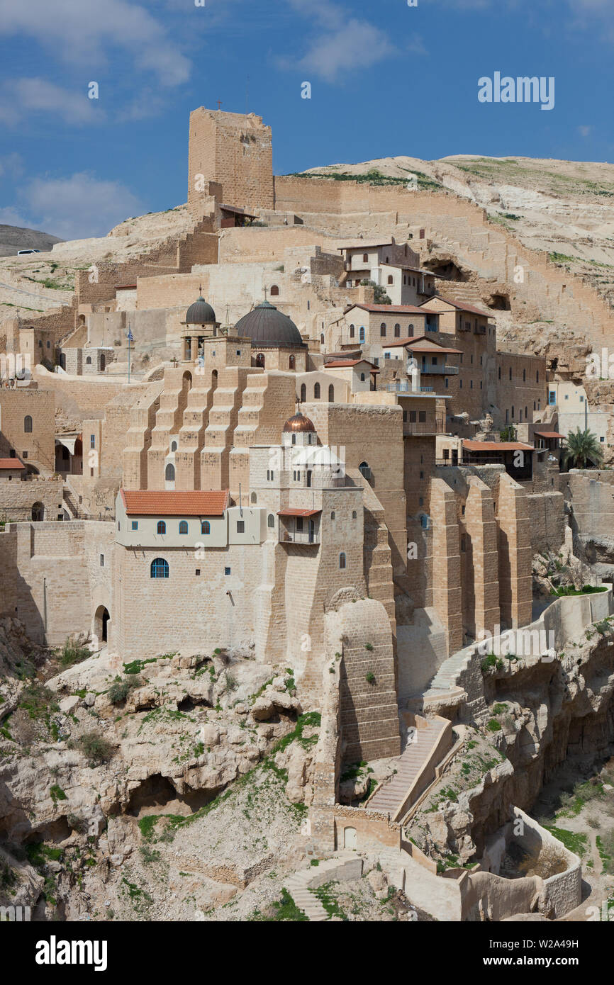 Panoramic aerial wide angle landscape of Holy Lavra of Saint Sabbas the Sanctified, known in Arabic as Mar Saba in the Judean desert in Israel. West B Stock Photo