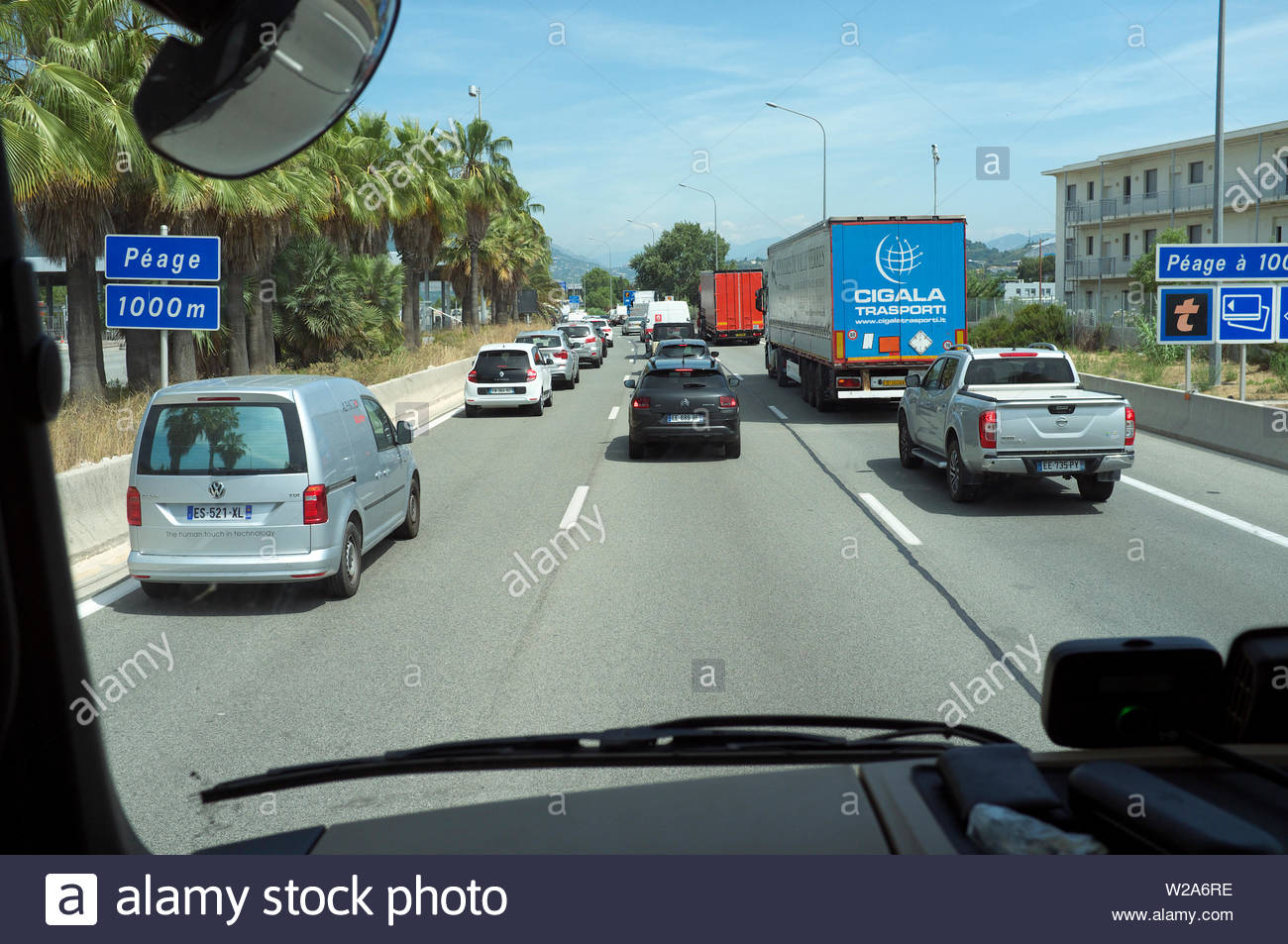 Lorry cab view - traffic congestion approaching the toll booths (péage), on the A8 / E80, in Nice, France. - Stock Image