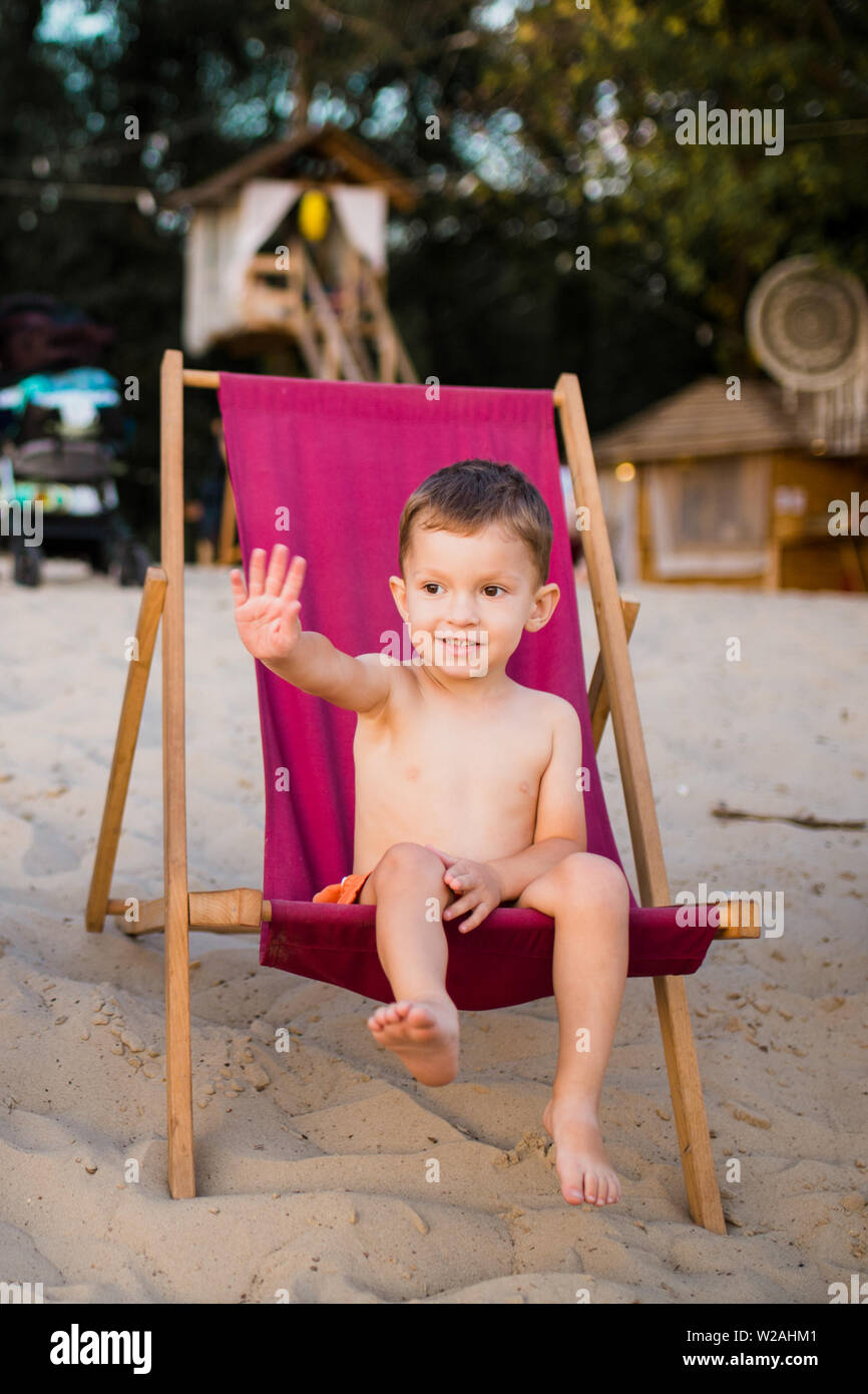 Beach Boy Little Beach Baby Sitting On Beach Chair Boy Sitting On The Chair By Sea Little Boy Sitting Alone On The Chair On The Beach And Looking Stock Photo Alamy