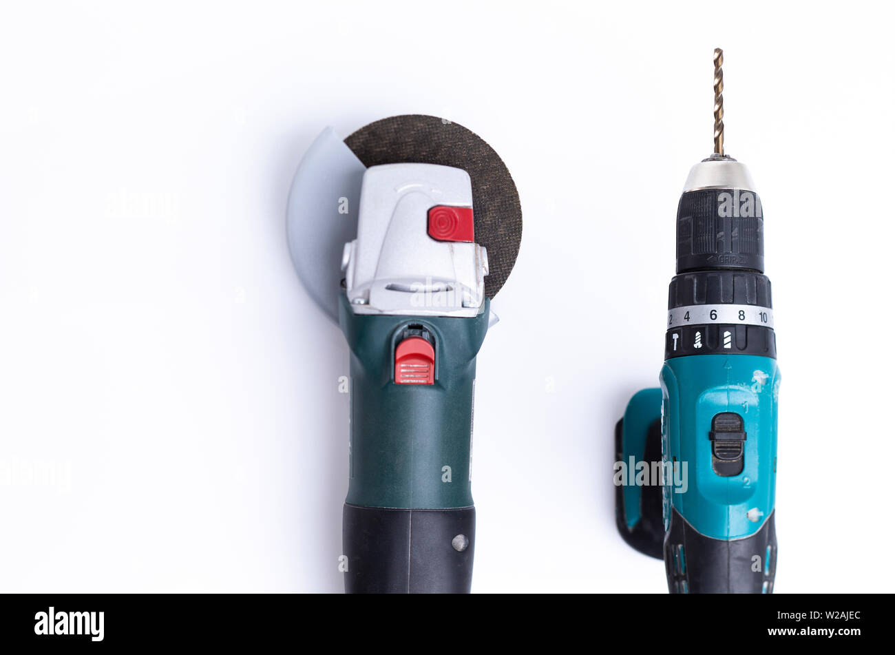 The image shows an angle grinder with a driller isolated on white - Stock Image