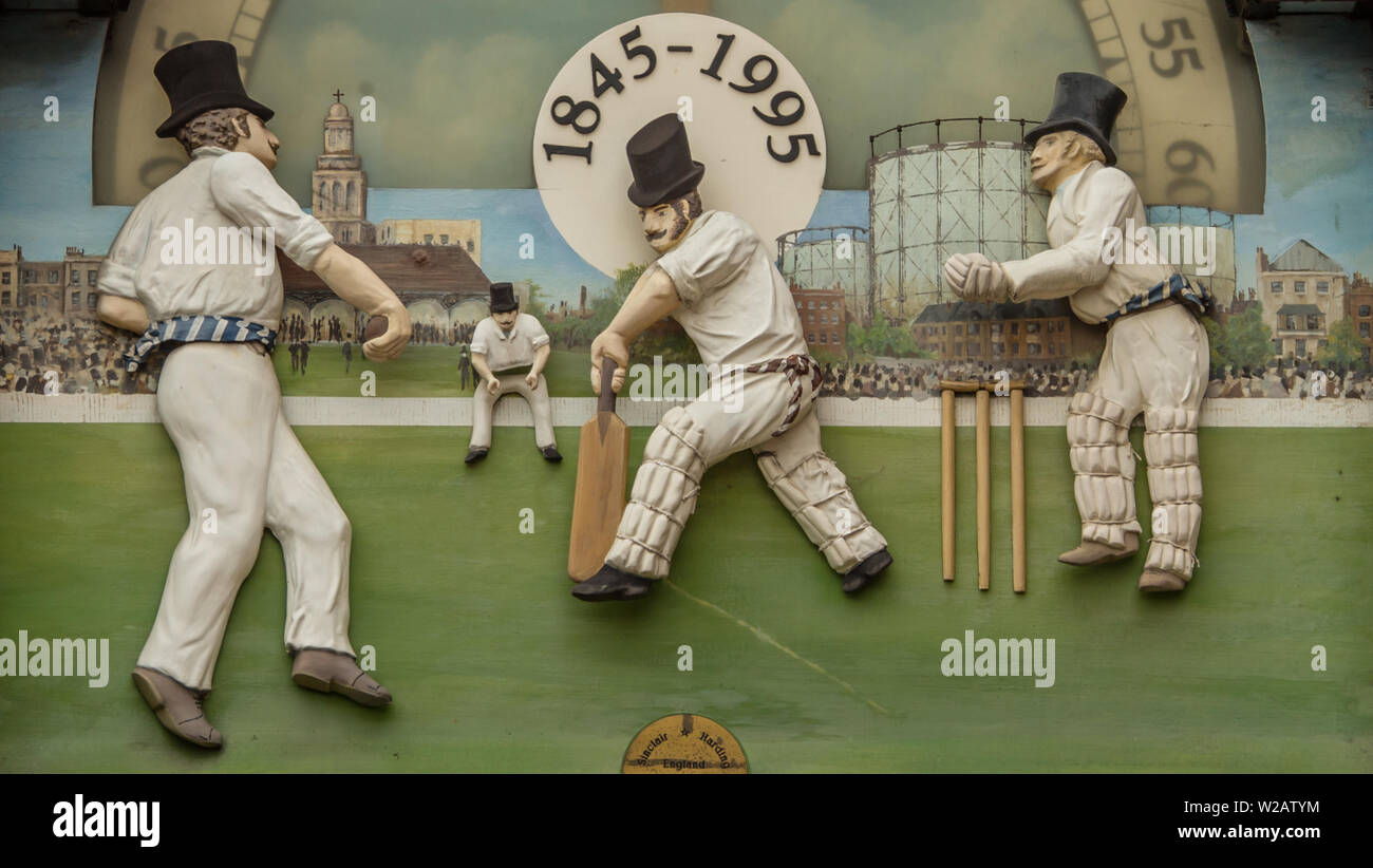 London, UK. 7 July, 2019. Cricket figure details on the old clock at the members entrance ahead of the first day of the Specsavers County Championship game between Surrey and Kent at the Kia Oval. David Rowe/Alamy Live News Stock Photo