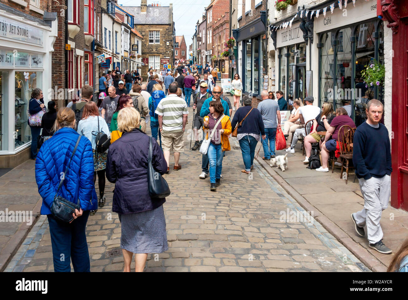 Historic pedestrianized Church Street in Whitby North Yorkshire UK busy with tourists in early summer - Stock Image