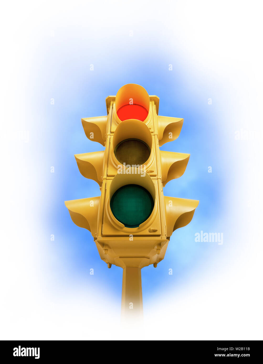 Upward view of tall vintage yellow traffic signal with red light on white vignette background - Stock Image