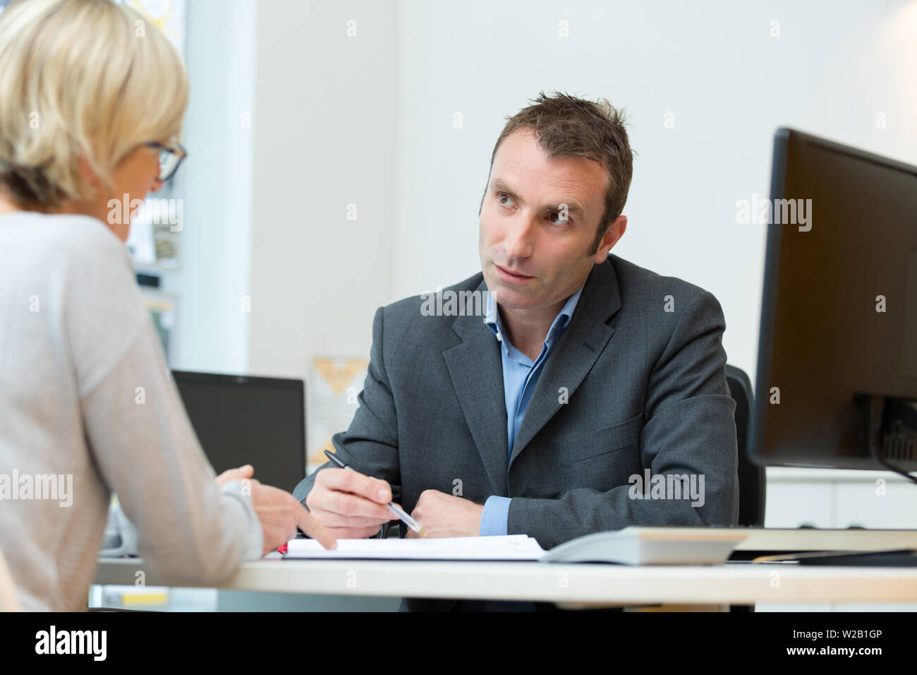 young bussiness couple in the office - Stock Image