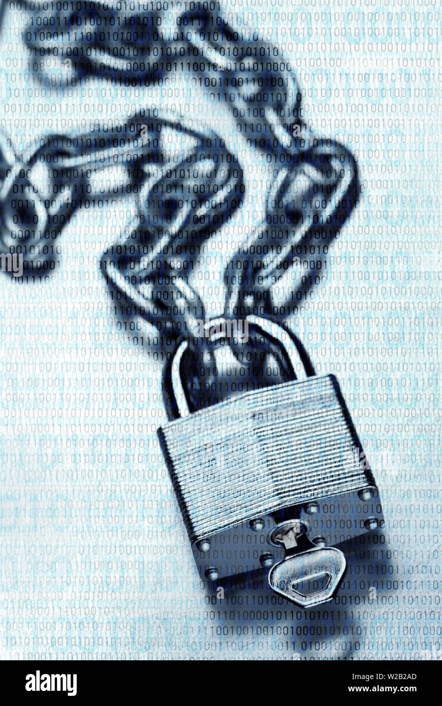 Digital security and encryption concept showing binary code overlaid on chain with steel padlock and key on scratched steel surface - Stock Image