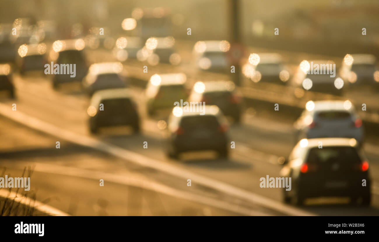 Heavy morning city traffic/congestion concept - cars going very slowly in a traffic jam during the morning rushhour - blurred photo - Stock Image